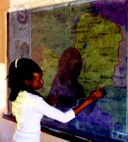 Tracing the Zambian map projected onto the blackboard